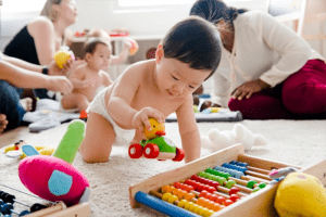 Baby playing with wooden toys